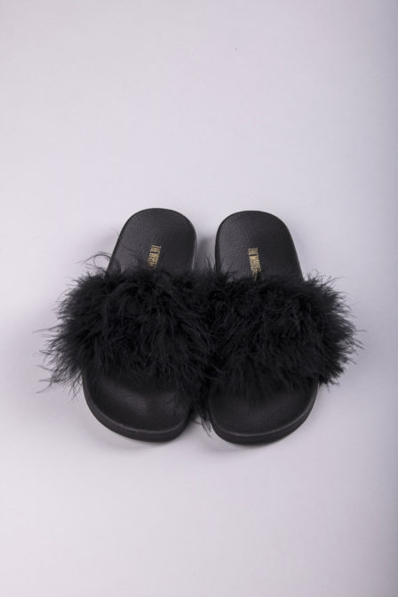 The white brand feathers slippers black