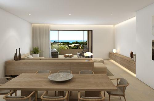 Lägenhet med privat trädgård och havsutsikt