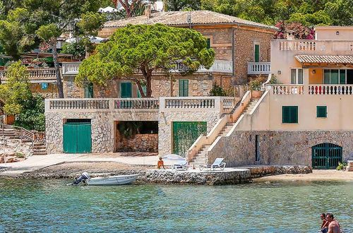 Mediterranean frontline residence with private sea access and boat landing