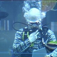 Reading his poetry underwater, in the marine aquarium