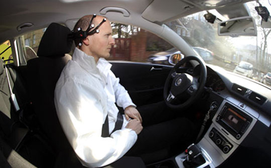 Goehring of the AutoNOMOS research team of the Artificial Intelligence Group at the Freie Universitaet (Free University) demonstrates a hands-free driving of the research car named 'MadeInGermany' during a test in Berlin