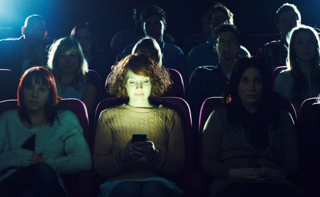 A new feature rumored to be in the next iOS update called Theater Mode could dim smartphone usage in cinemas.