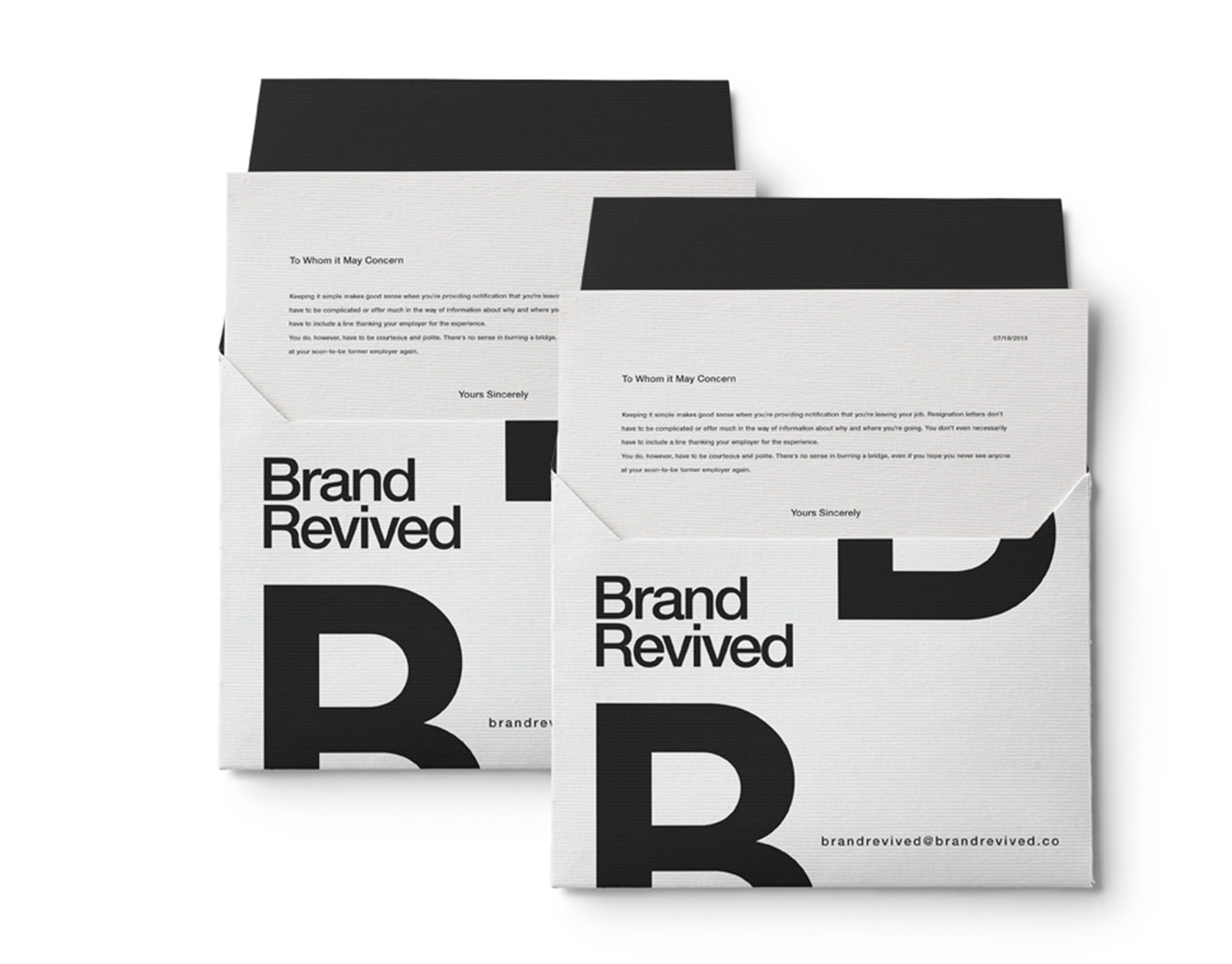 Two black and white envelopes with large typefaces