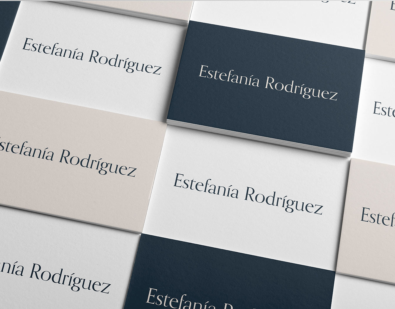 Laid pattern of business cards with one name.