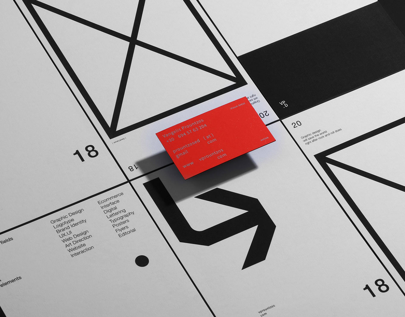 Red business card in contrast with black and white stationary