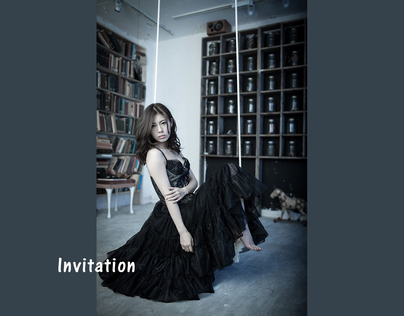 Asian woman posing on invitation for house-warming
