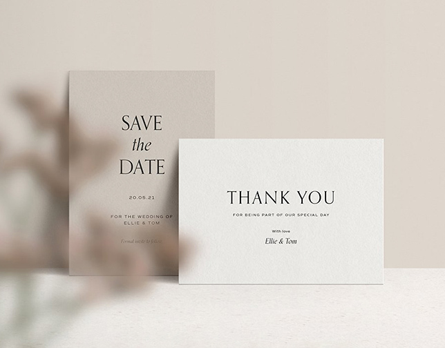 Two white wedding invitations with leaves decoration