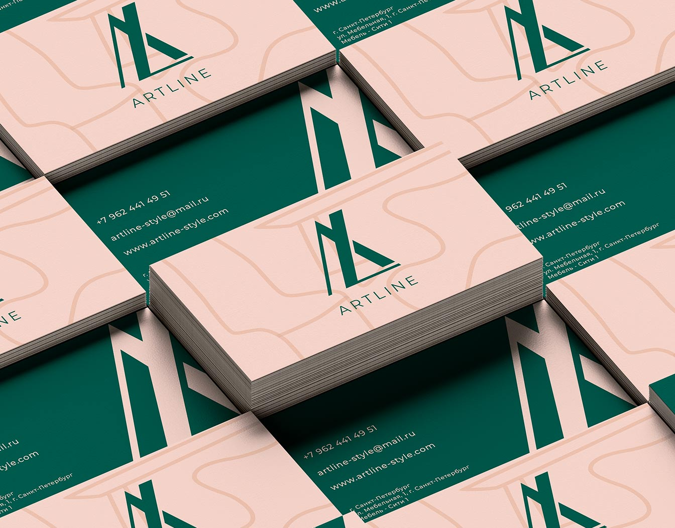 Green and brownish business cards stacked together