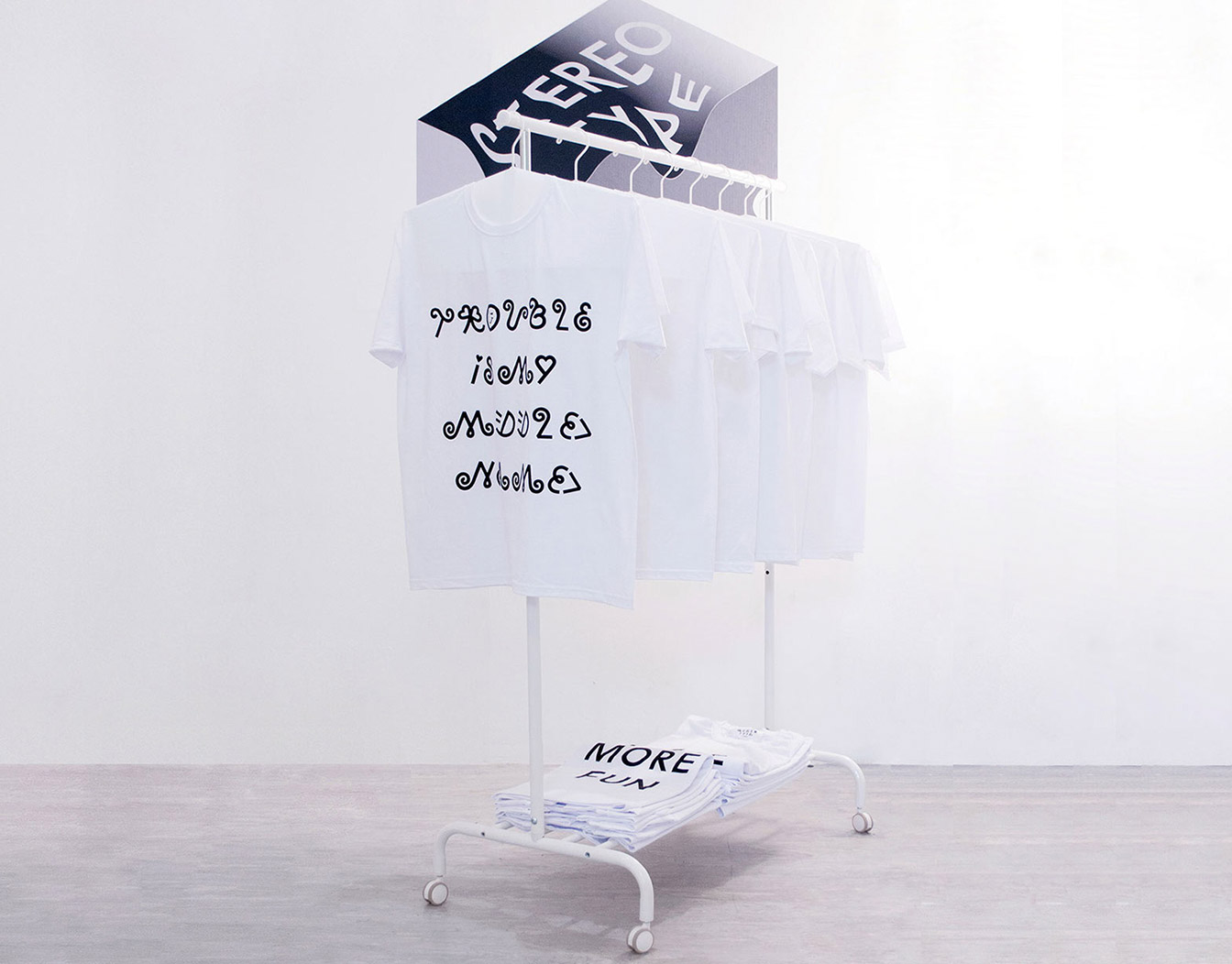 White tshirts on hanger with slogans