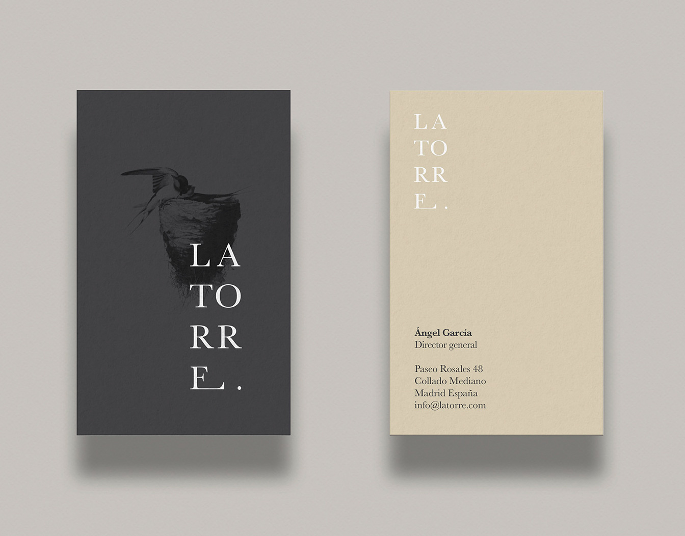 Two business cards in beige and grey.