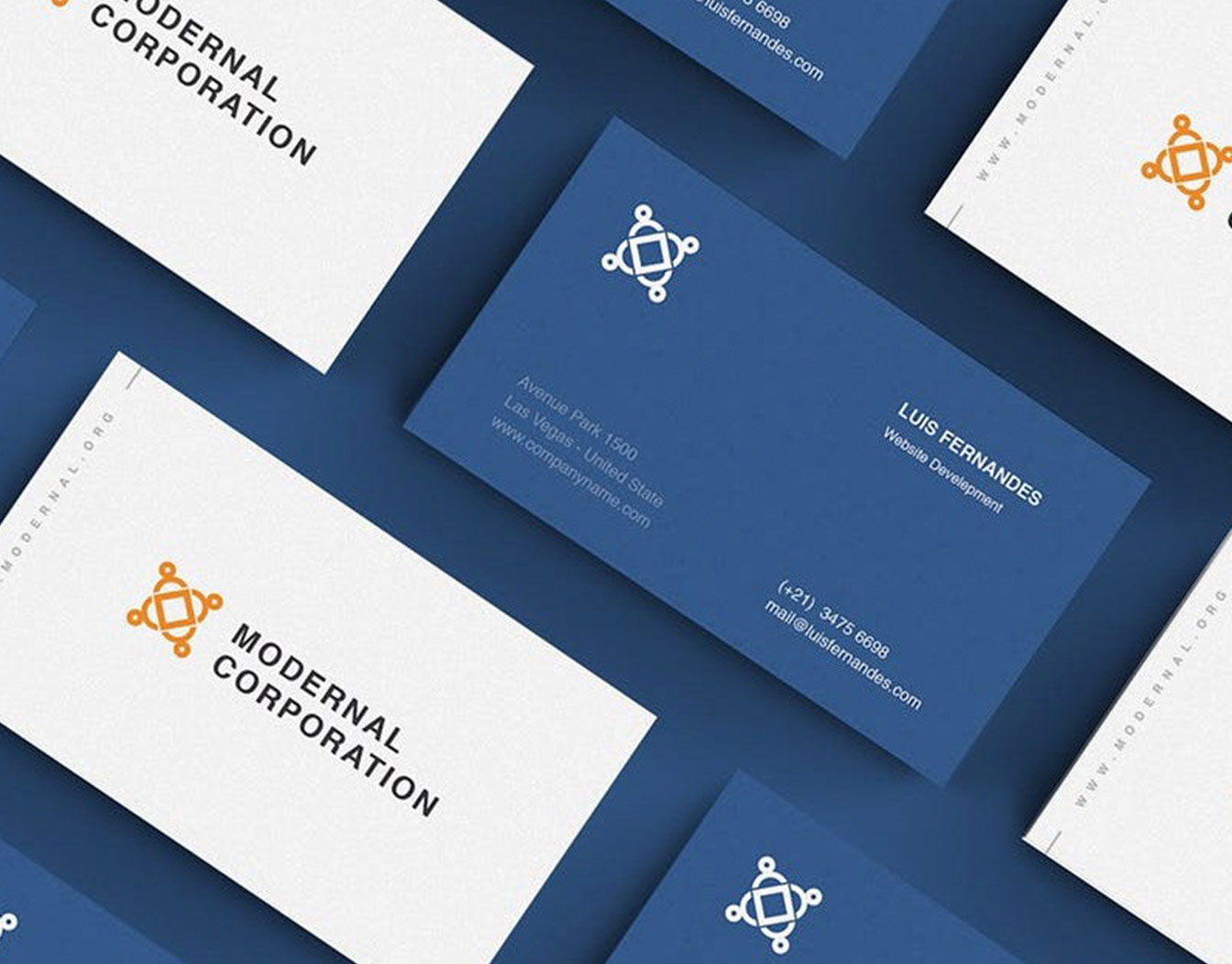 Corporate white business card on blue background.