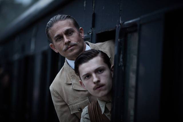 Civiltà perduta Charlie Hunnam Tom Holland foto dal film 4