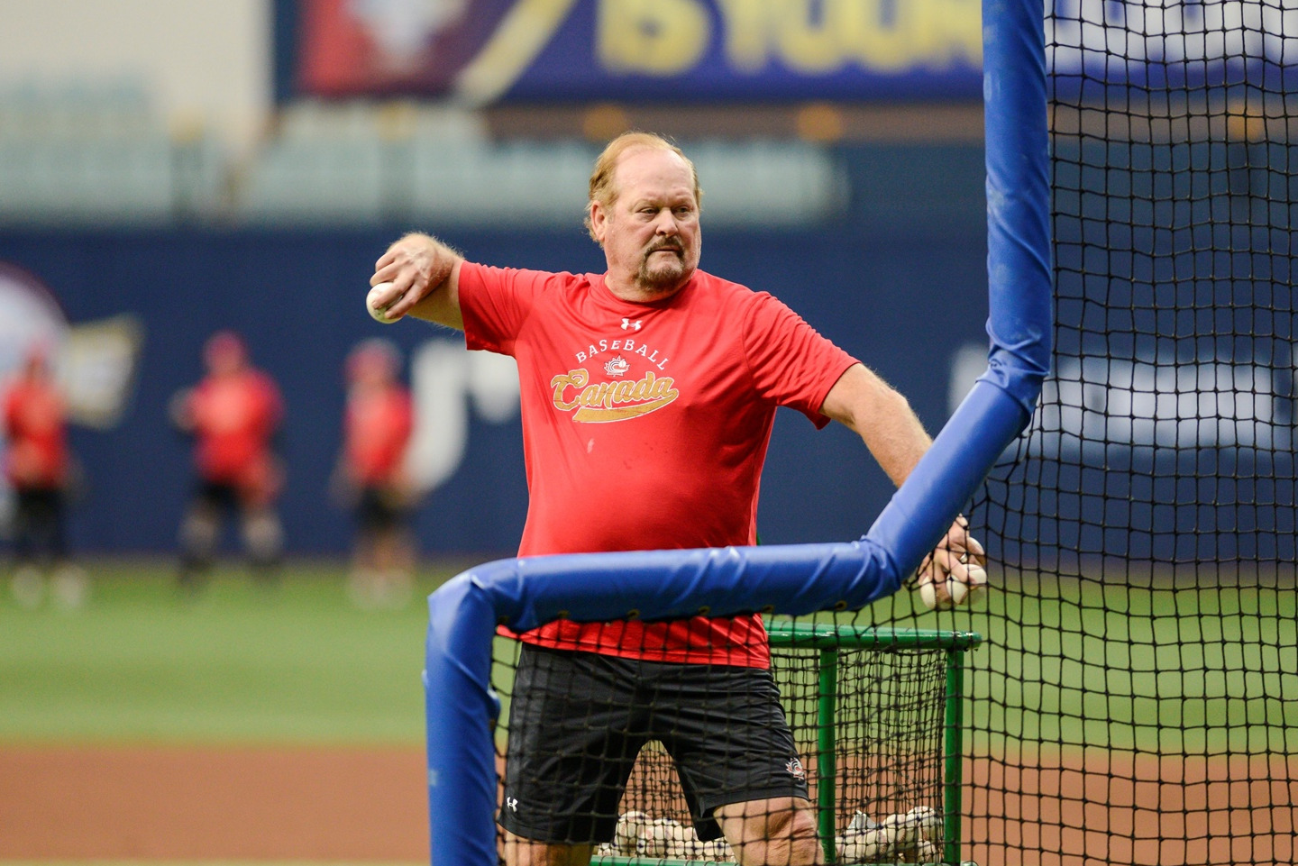Canada's manager Ernie Whitt throws batting practice