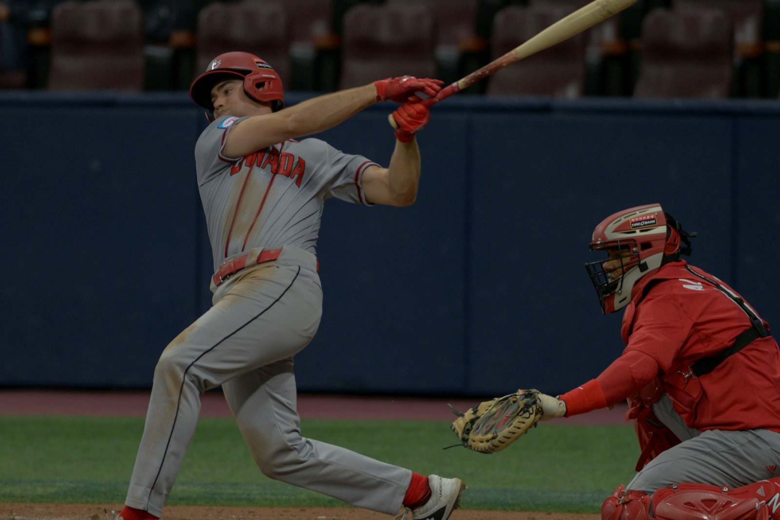 Eric Wood doubled and scored the first run by Canada