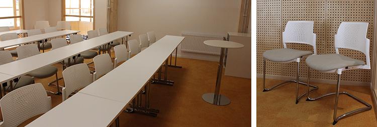 Foto från mötesrum Copernicus med solgult golv, vita stolar och bord.