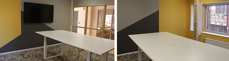 Foto från mötesrum Christiansson med vitt ståbord, geometriska mönster på väggar och golv.