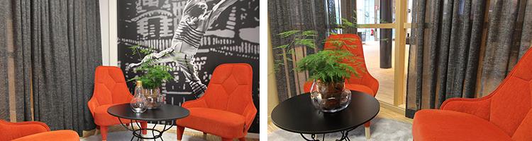 Foto på samtalsrum Cullberg med orange fåtöljer, ett litet bord och en tapet med en modern balettdansare.