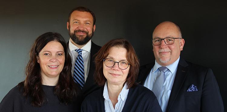 Foto på ledningsgrupp för Videum AB: fastighetschef Cissi Carlsson, affärschef Robert Unt, administrativ chef Ingrid Johannisson och VD David Svensson.