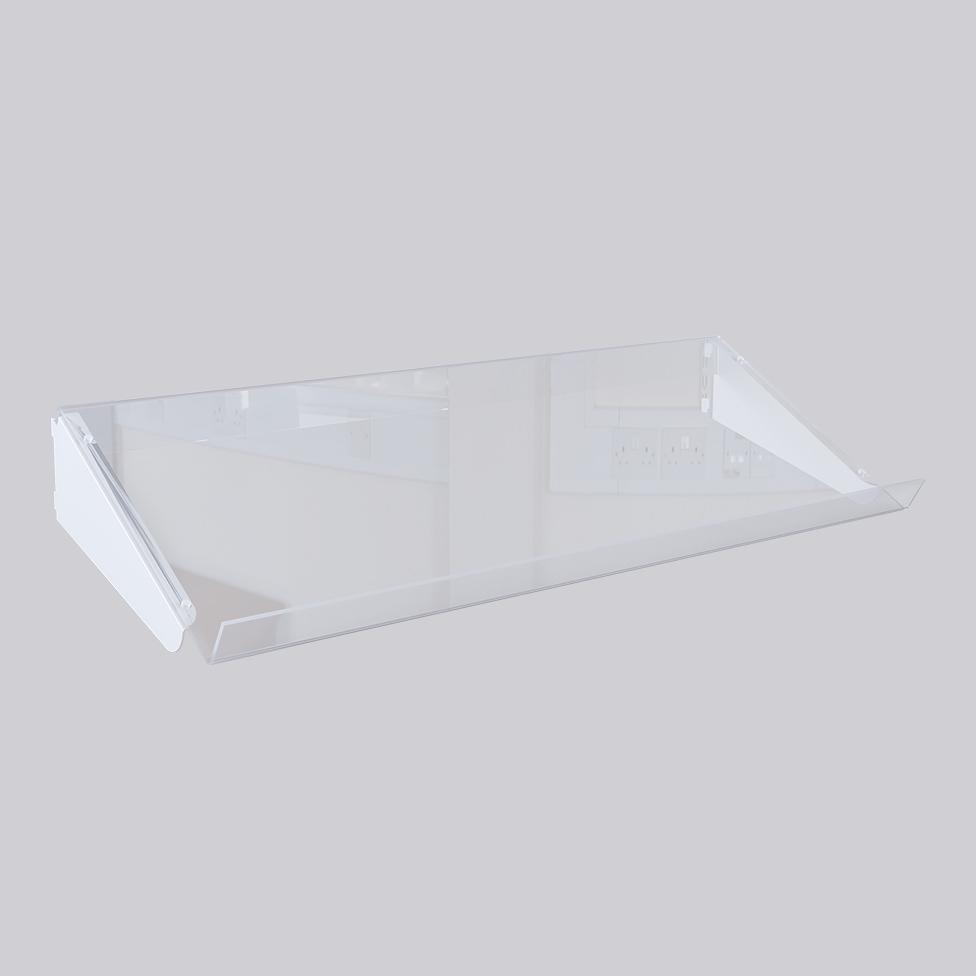 Plexiglashylla med konsoler