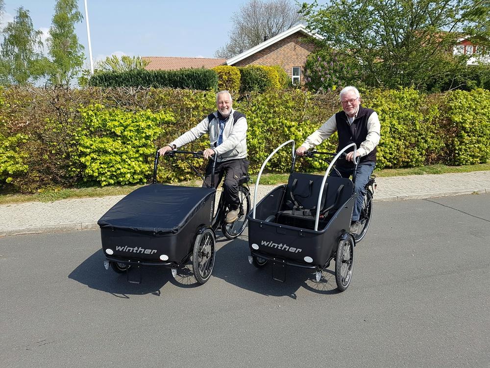The chairmen on their cargo bikes.