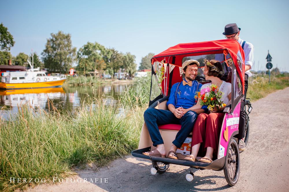 Cargo bike rickshaw driving a couple to their wedding.