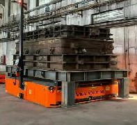 AGV moving big castings at foundry.