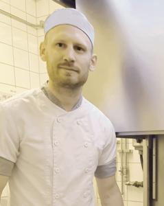 blond millennial man restaurant manager max burgers