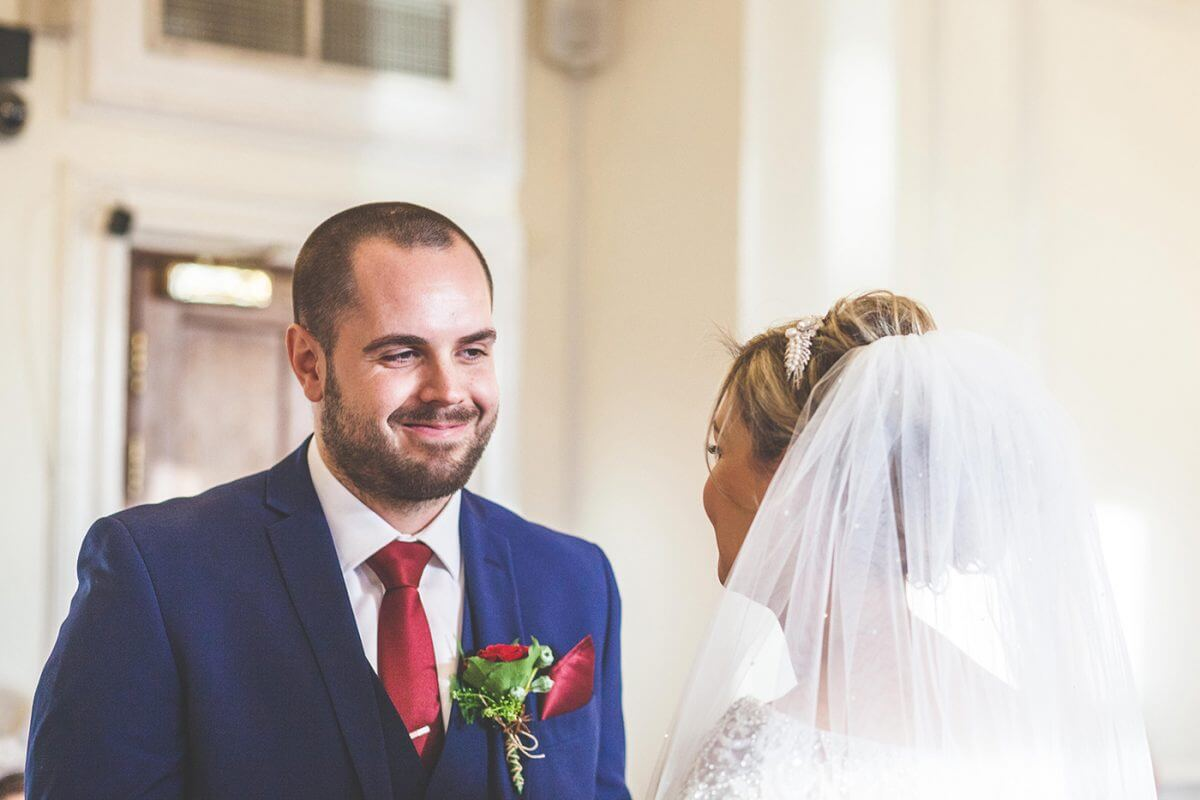 groom looking at bride at Lancashire wedding venue