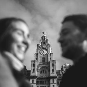 couple in front of liver building in liverpool