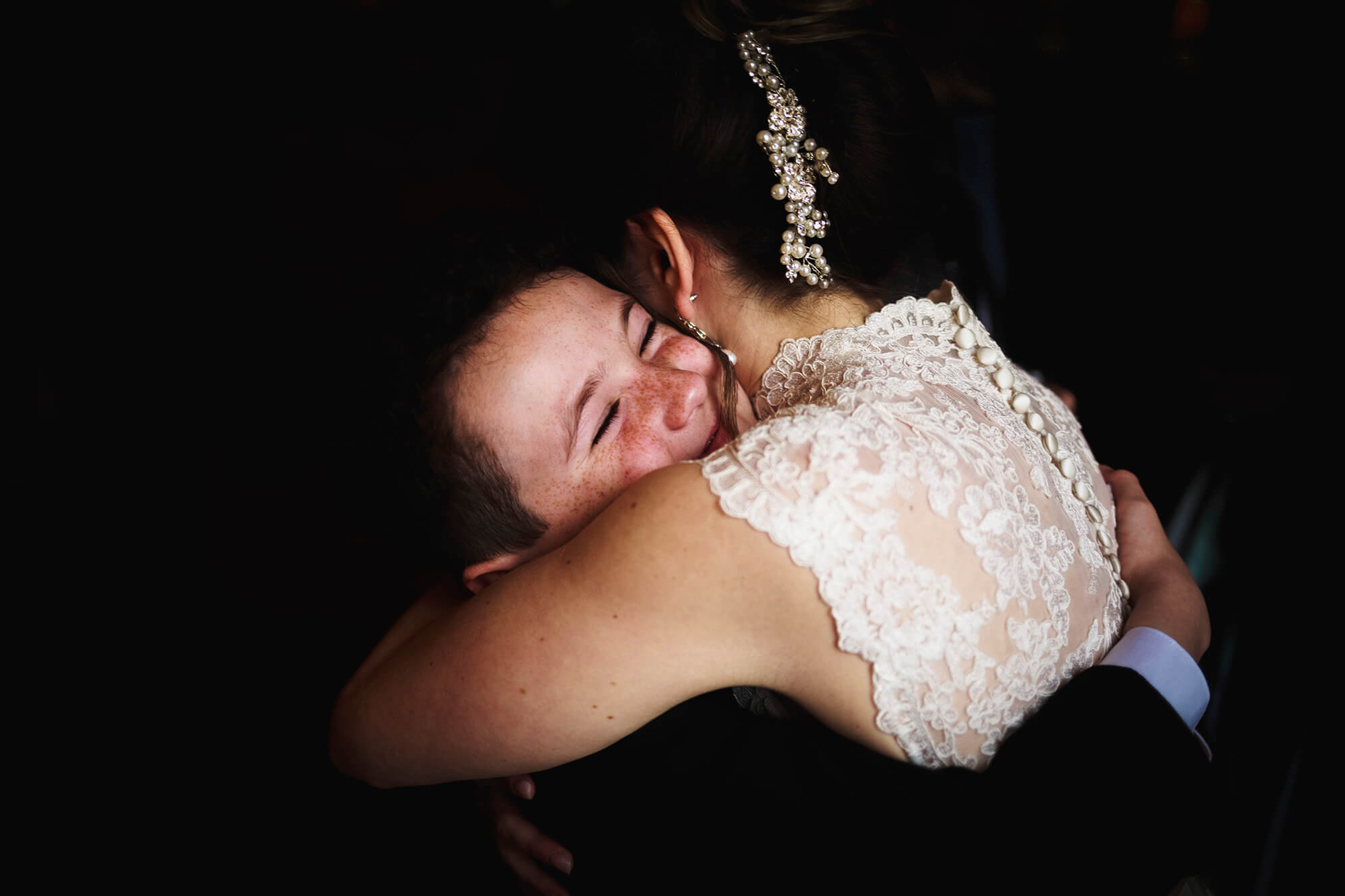 a hug with the bride