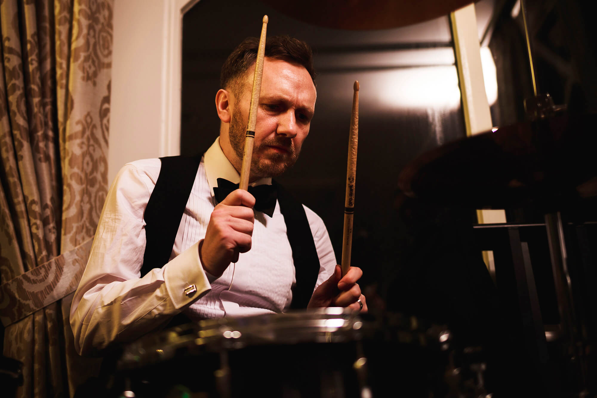 groom and drummer at his own wedding in Cheshire