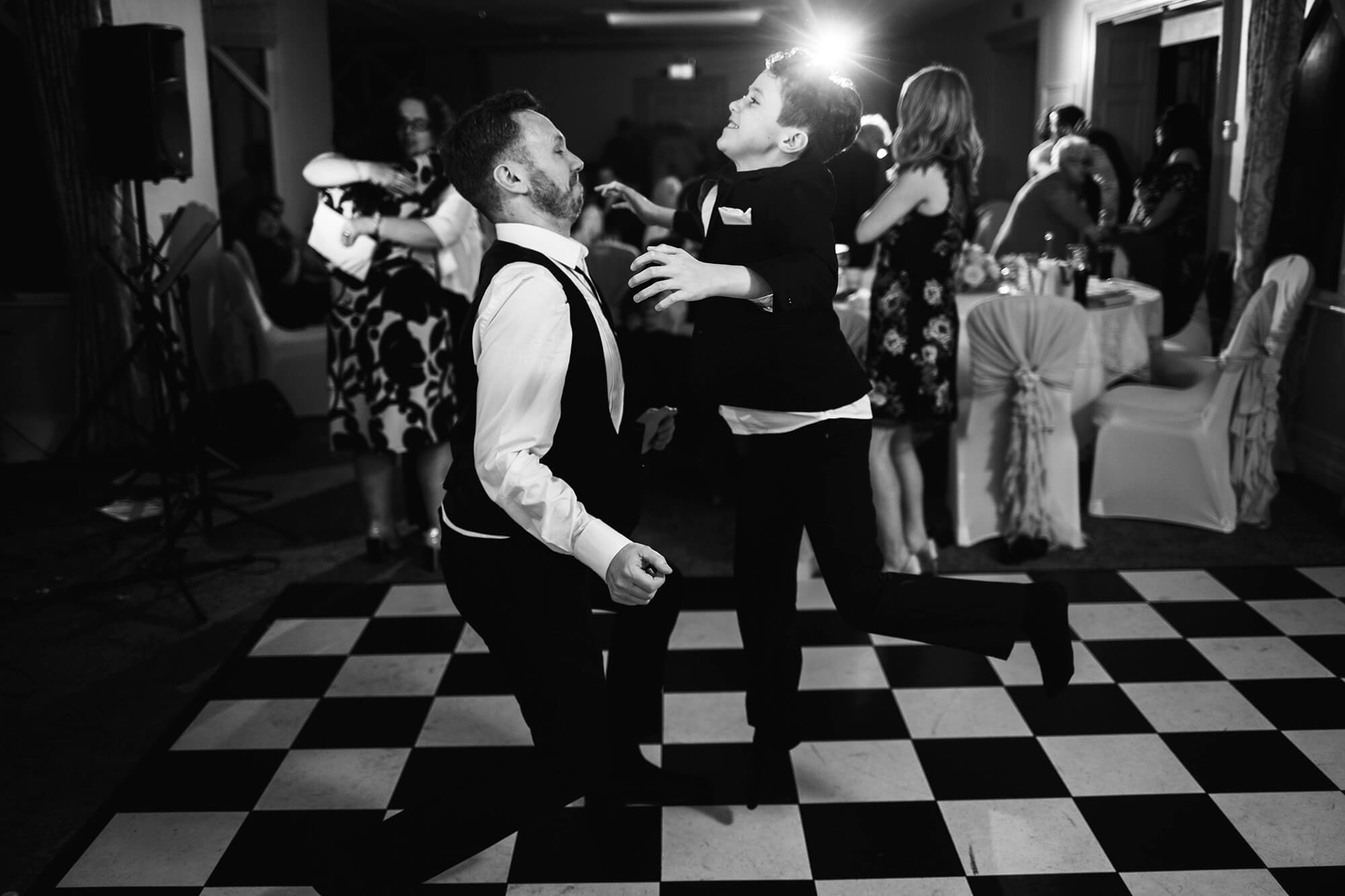 Dale and Son Zane dancing and busting moves at wedding