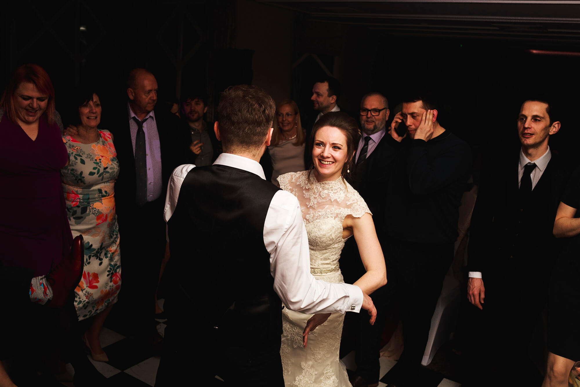 happy bride dancing with her groom in Cheshire