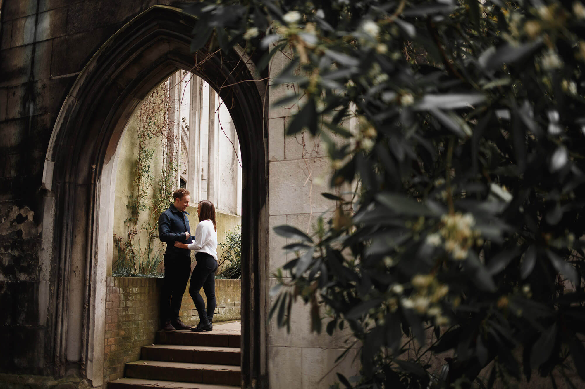couple standing in London archway