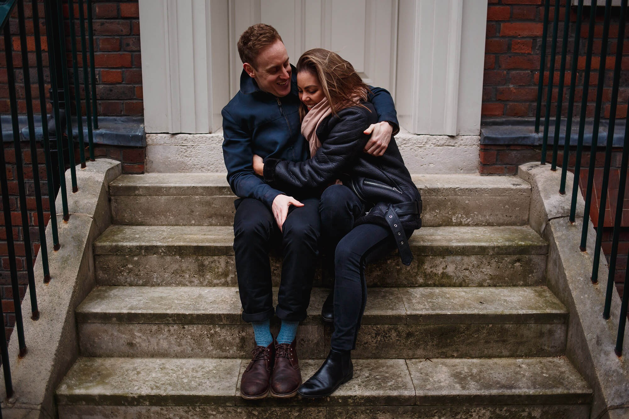 London couple sat on steps