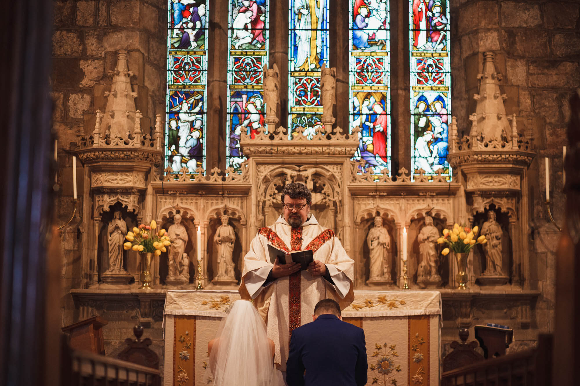 priest gives service at wedding