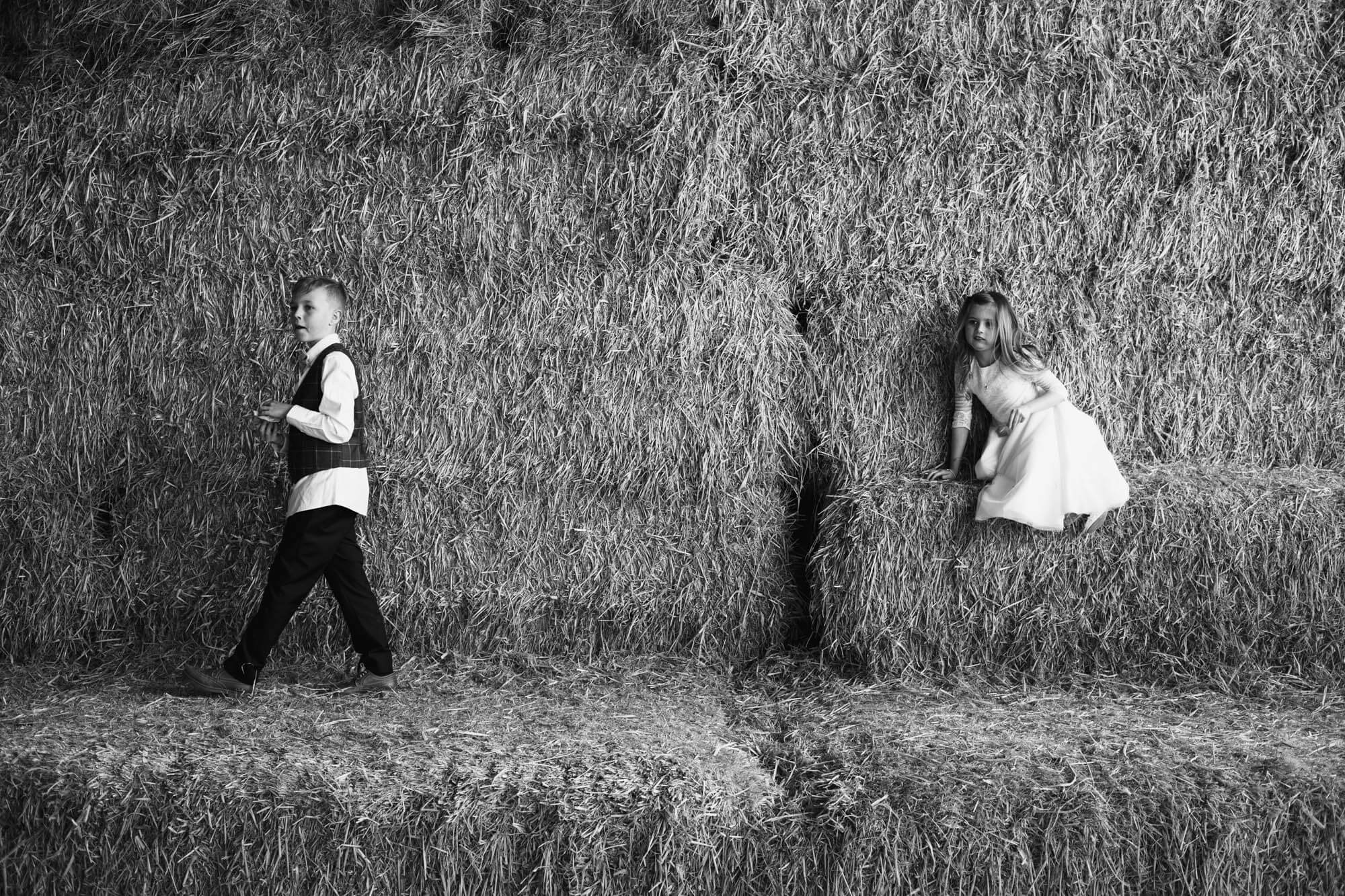 kids playing on hay bails