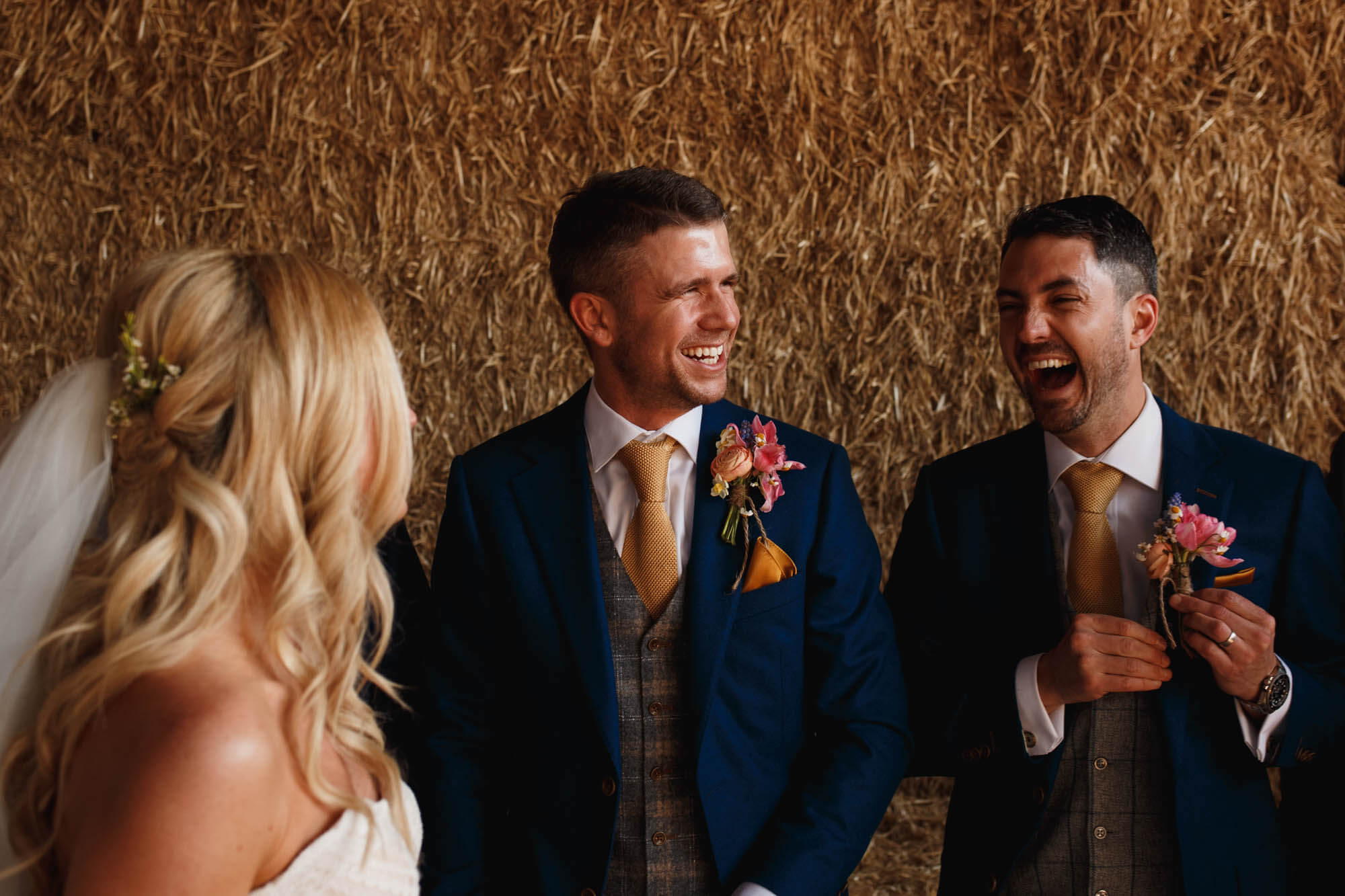best man at wedding laughing