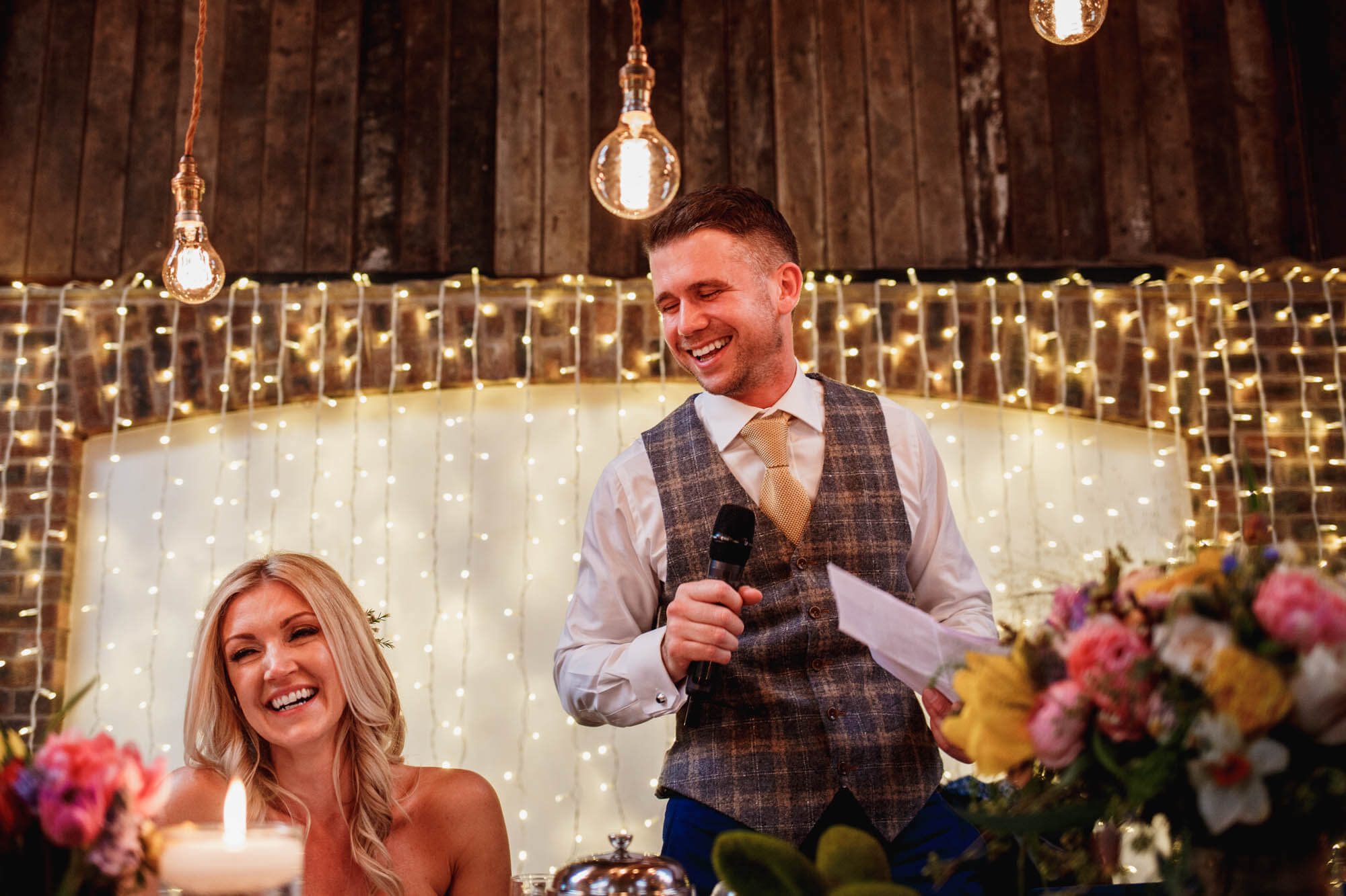 groom speaking with his wife in cheshire wedding