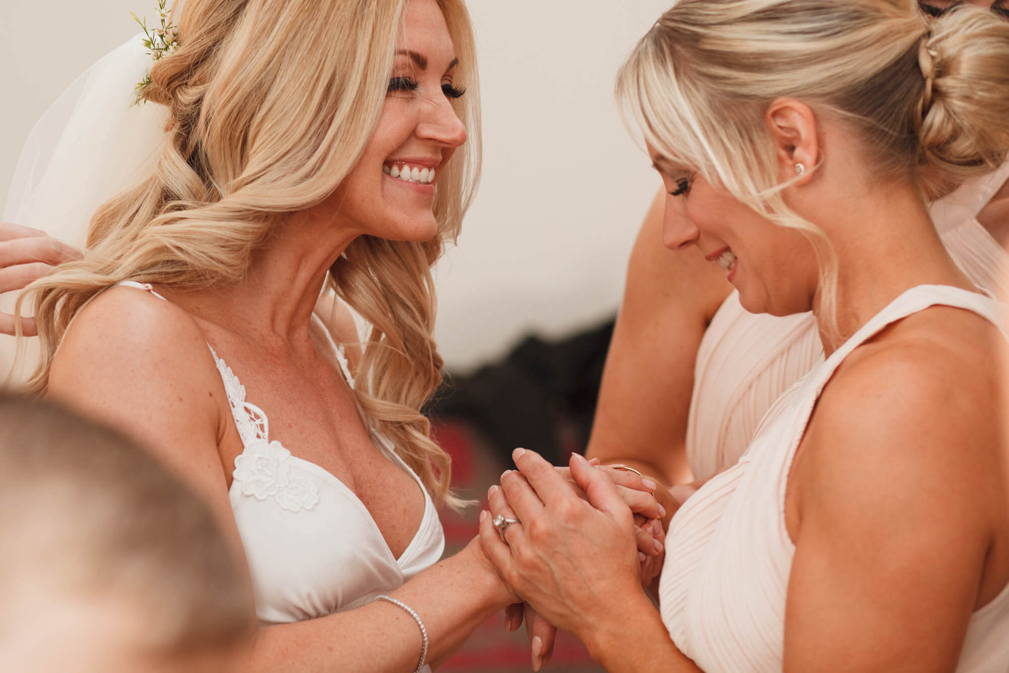 excited bride with close friend