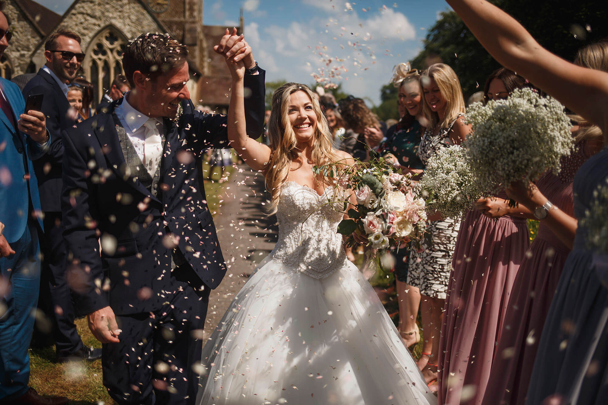 confetti shot of couple at surrey church