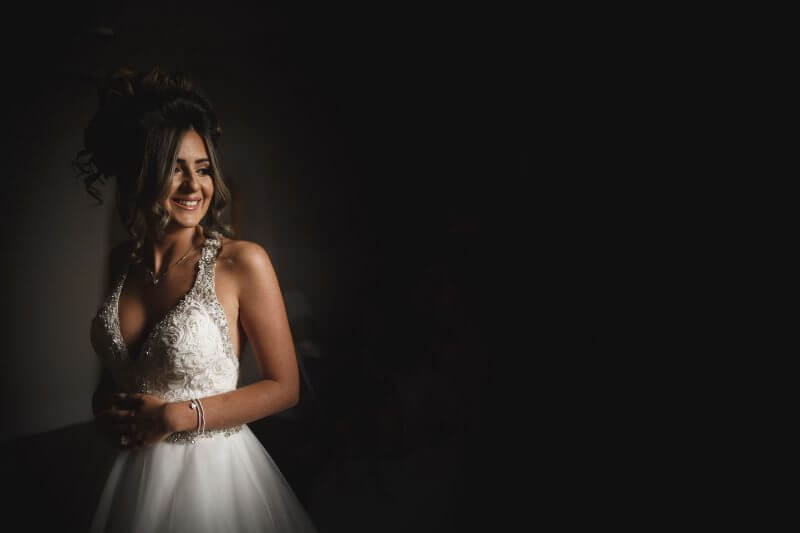 bride stood in window light in wigan