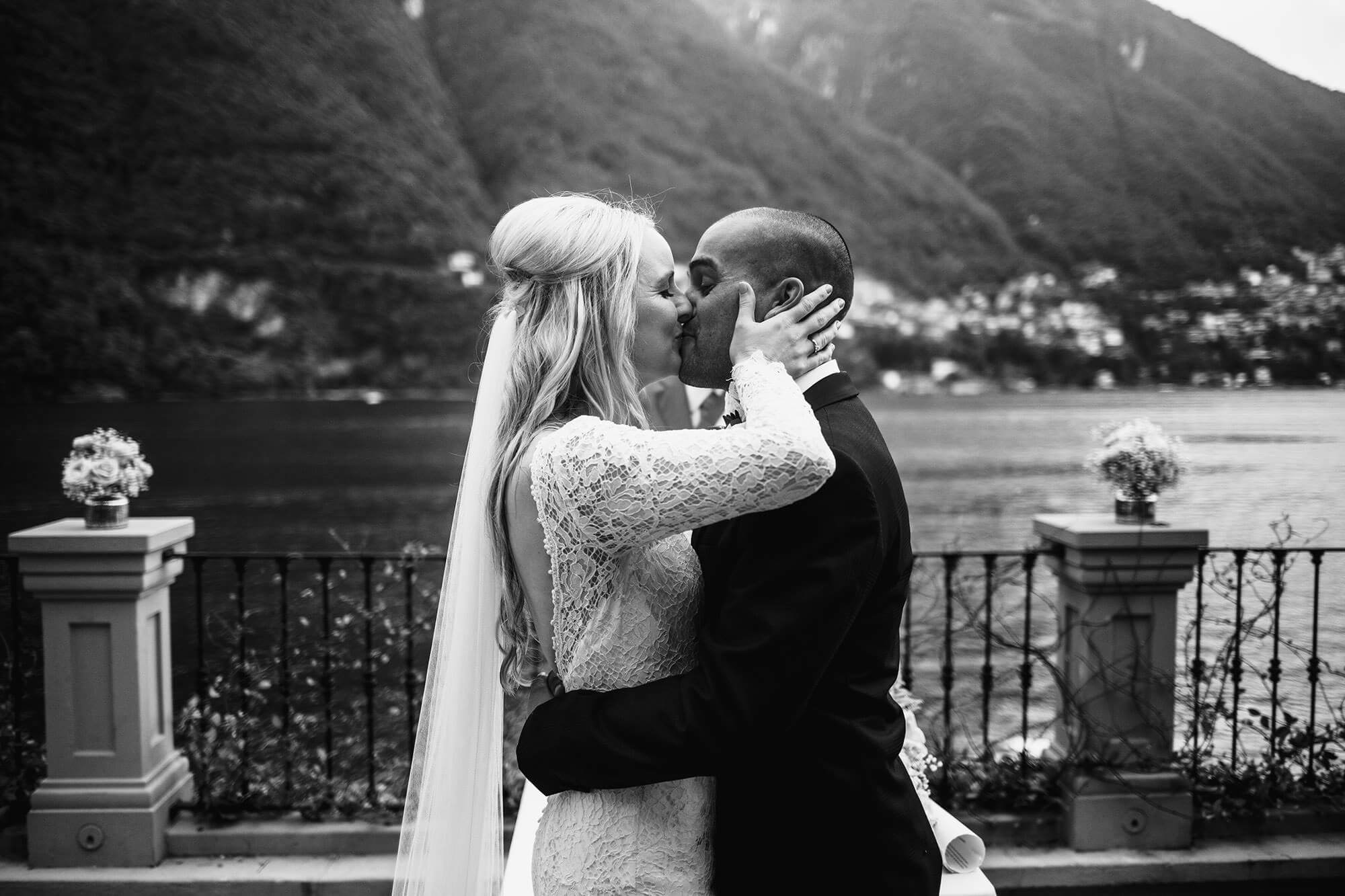first kiss as husband and wife on lake Como