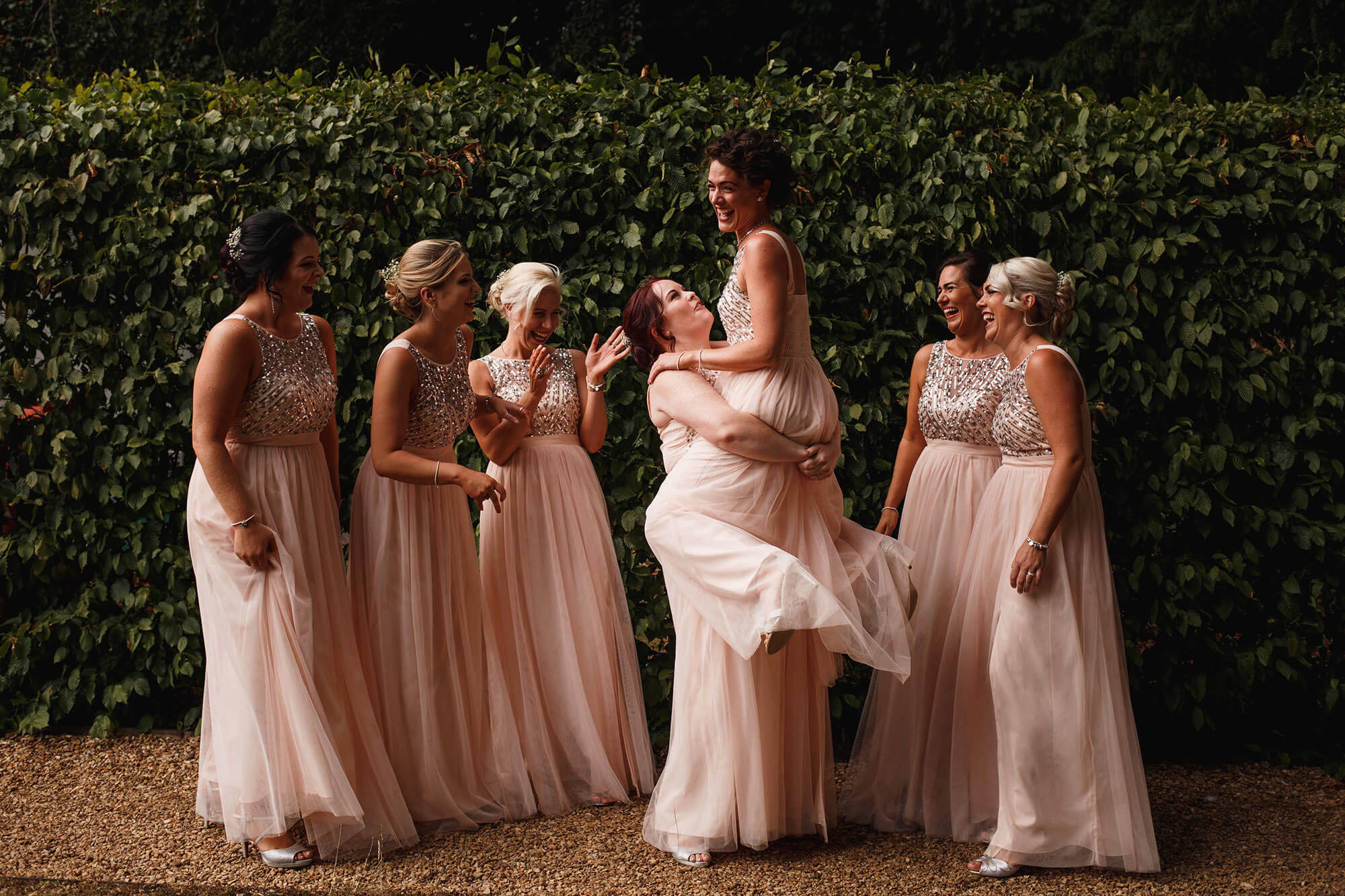 bridesmaids having fun at stamford wedding
