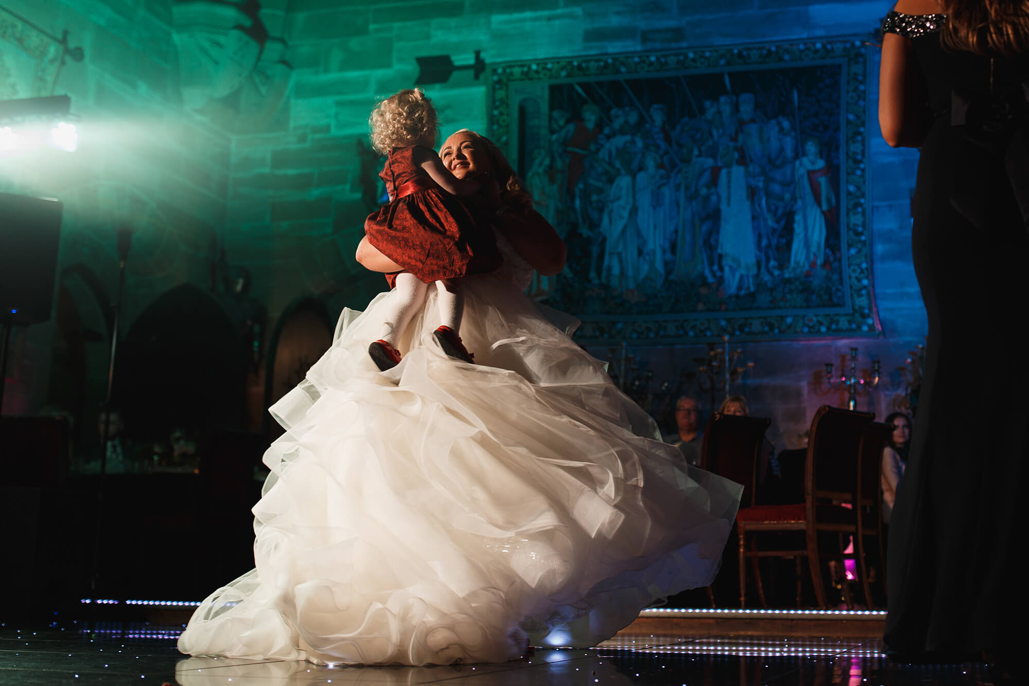 bride dancing with little girl at Peckforton Castle