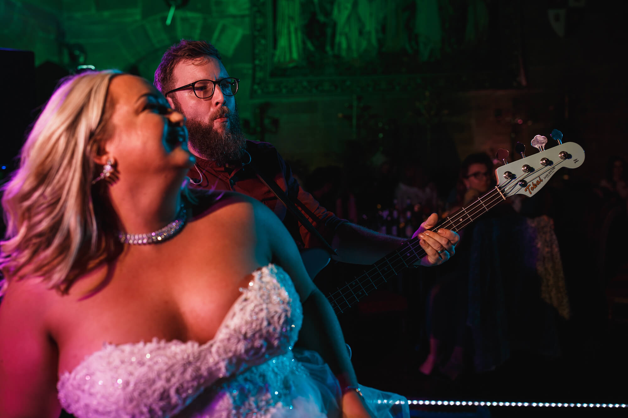 bride dancing with bass player at wedding