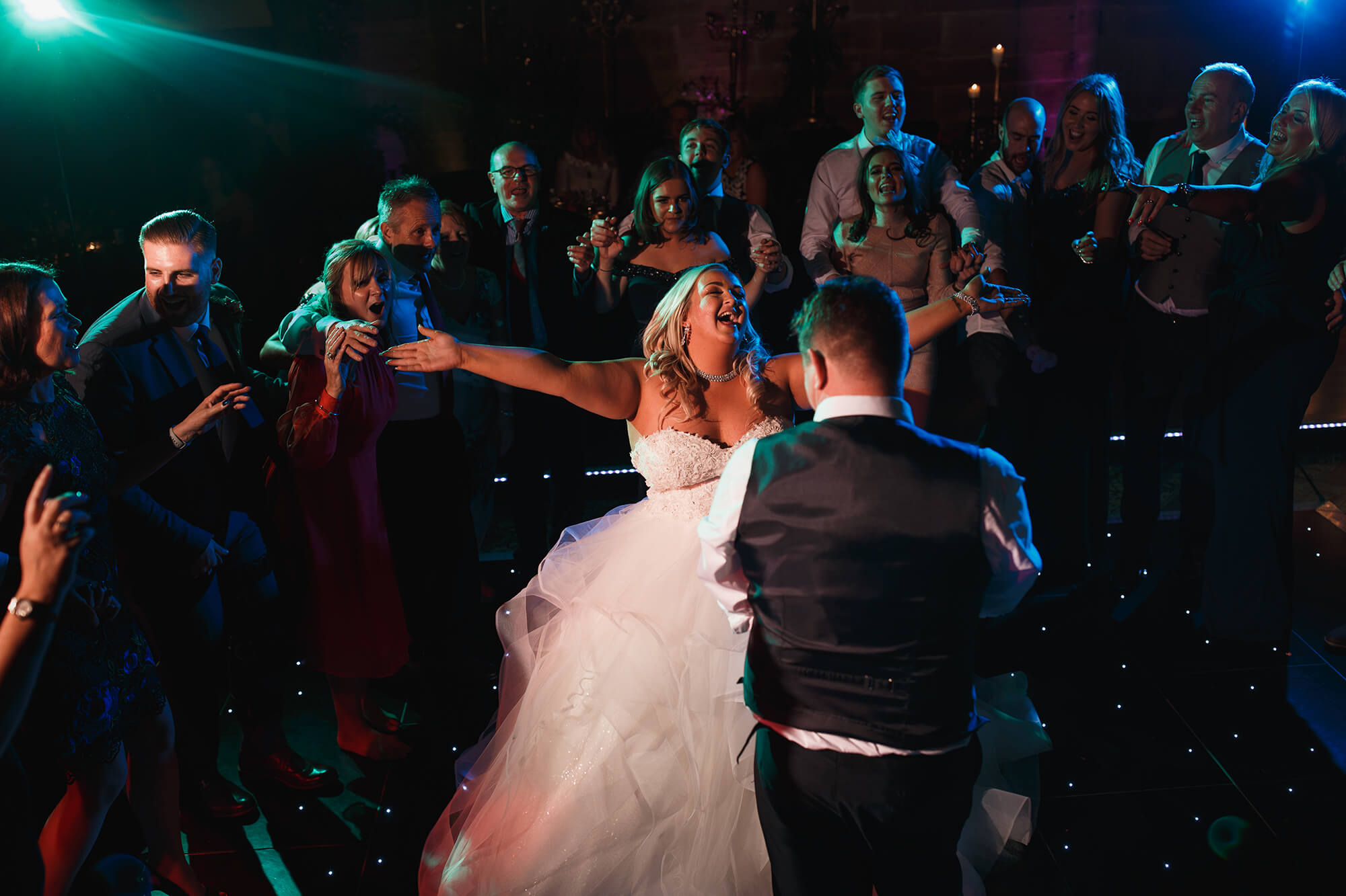 happy bride on dance floor at Peckforton Castle