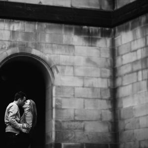 couple kissing in Manchester archway