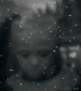 Barnet bakom fönstret