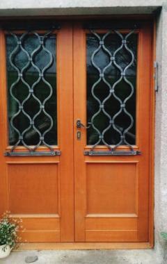kovaná cibulová dveřní mříž
